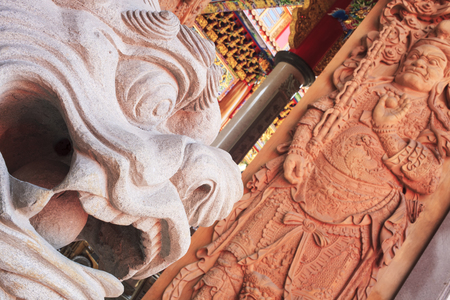 places of worship: Wood carving Buddhist temple door public places of Buddhist worship