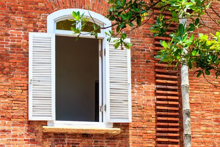 panes: The Old Brick Wall with White Window