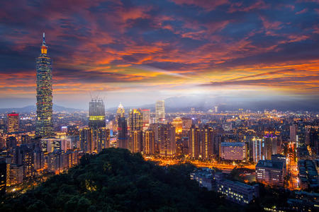 The Taipei city towers over the Xinyi District at twilight Stock Photo