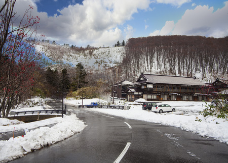 The beautiful road in mountain with nice view of snow in Spring Editorial