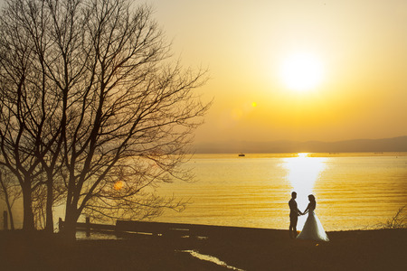 The Wedding couple just married at the beach, Japan. Wedding ceremony