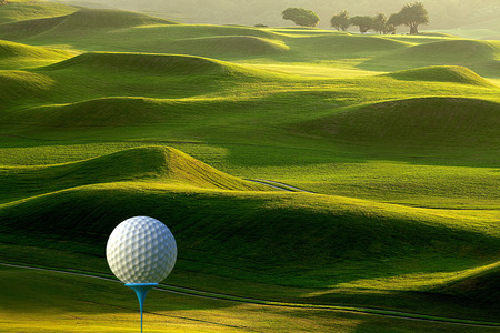 The 3d rendering of Golf ball on tee over a blurred green