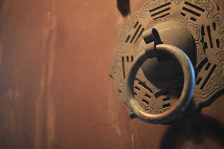 The weathered wood texture on old door with rusty beautiful doorknob Banco de Imagens