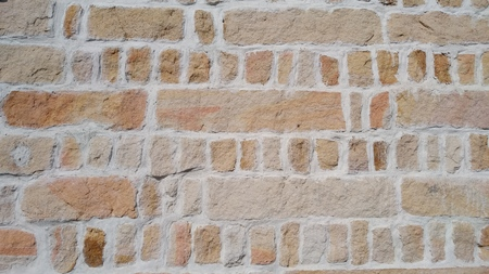 The Weathered stained old brick wall background Stock Photo