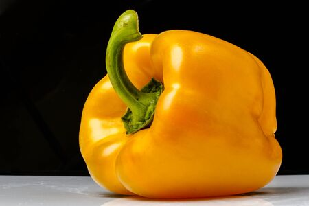 Yellow pepper on a black background Banco de Imagens