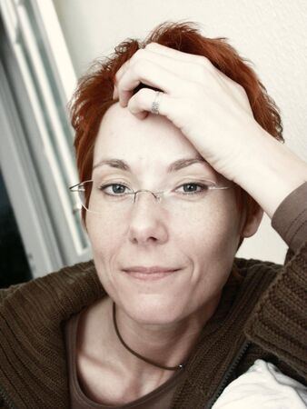Portrait of a woman, red hair, glasses Stock Photo