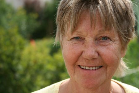 crinkles: portrait of a smiling retiree, female