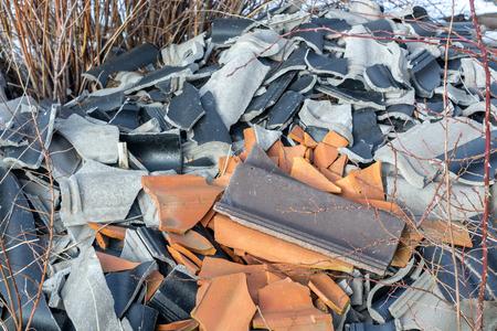 broken tiles black, gray and orange color close-up