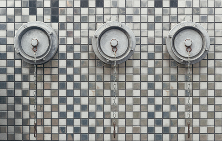 fire hydrants on the wall with mirrored mosaics