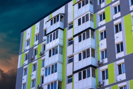 Multistorey apartment house on a blue cloud heaven