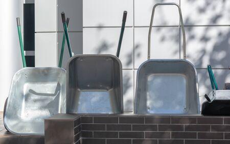 construction wheelbarrows near the store day closeup