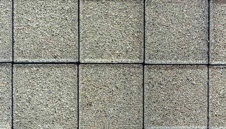 Brick pavement tile, top view. Urban texture as background. Stone pavement texture. Granite cobblestoned pavement background. Archivio Fotografico
