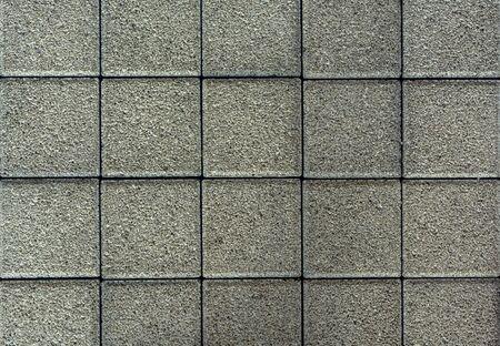 Brick pavement tile, top view. Urban texture as background. Stone pavement texture. Granite cobblestoned pavement background. closeup