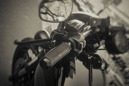 handle on the handlebars of a motorcycle closeup Stock Photo