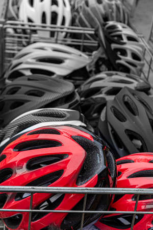 sale of bicycle helmets of different colors. bicycle helmet in the basket