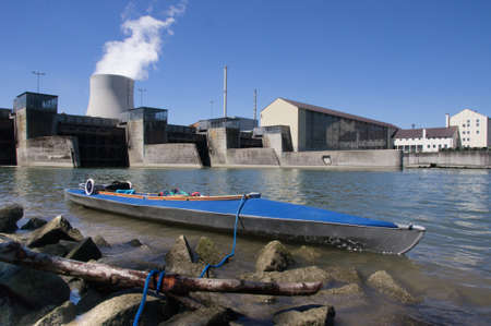 power boat: little folding boat in front of nuclear power plant