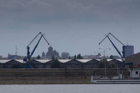 southeast europe: Shipyard and largest orthodox Cathedral in the background Stock Photo