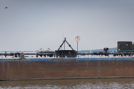 southeast europe: Rusty Freighter with no humans allowed sign