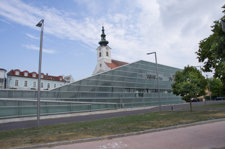 electronica: Parish Church and parts of the Ars Electronica Center in Linz Stock Photo