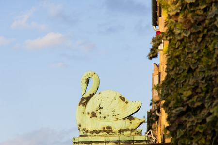 a old rusty swan sign