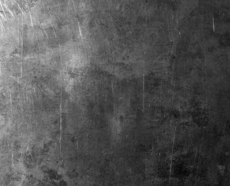 old scratched metal texture is shaded on one side photo