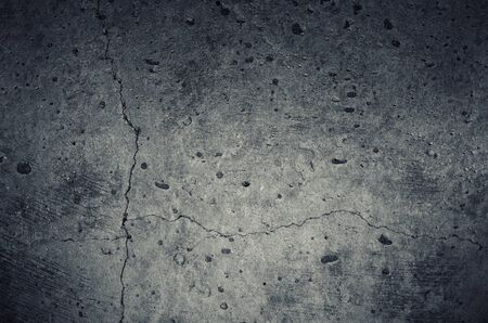 shabby concrete wall texture with cracks, scratches, holes Stock Photo