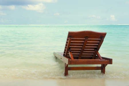 sunbed: chaise lounge in the water on the ocean  landscape Stock Photo
