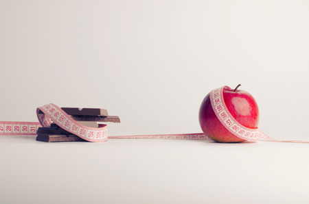 Make your choice of red apple or chocolate  Depends on this weight  Stock Photo