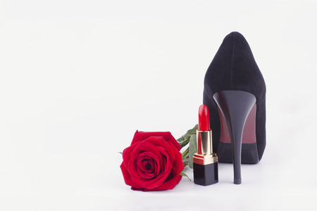 womens heel, lipstick and a rose on a white background Stock Photo