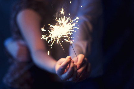 hand colored: sparklers in the hands of a loving couple