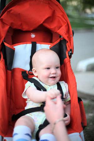 Baby in sitting stroller #1 photo