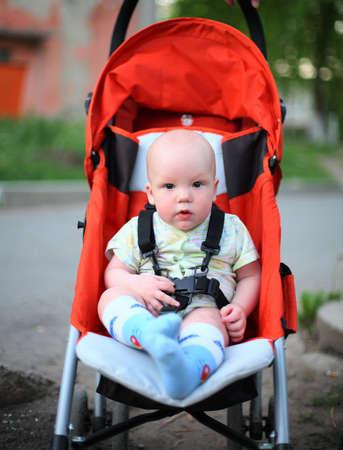 Baby in sitting stroller #6 photo