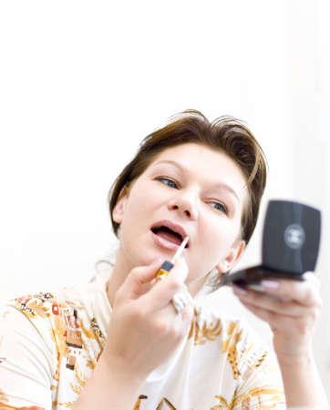 Woman doing a make-up #1 photo