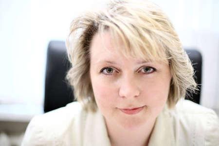 Mid-life business woman look at camera photo