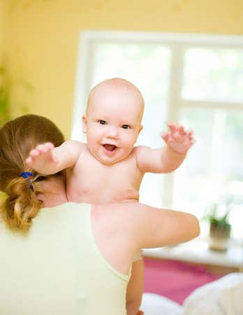 Mother holding enjoying baby Stock Photo - 1092239