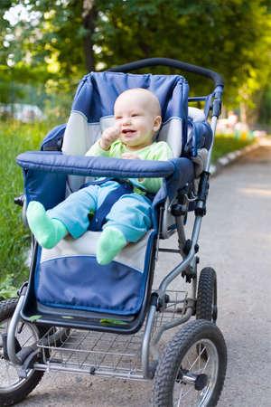 Baby in sitting stroller #10 photo