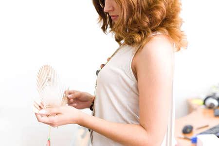 Girl in office unfold fan #2 photo