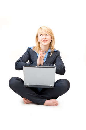 shoeless: Shoeless woman with laptop do meditative exercises Stock Photo