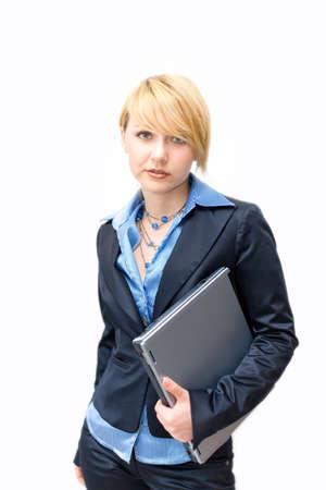 Businesswoman holding laptop under ones arm photo