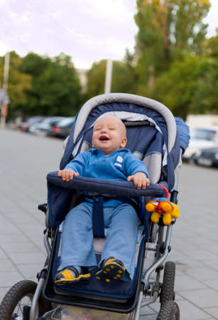 Smiling baby in sitting stroller #12. View my another photos from this series. photo
