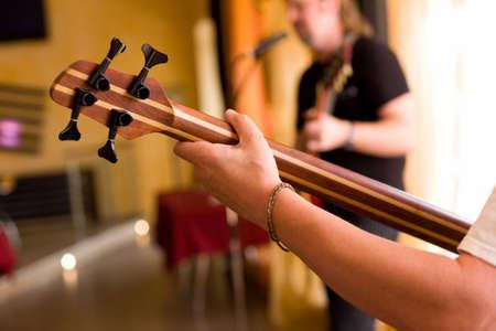 fingering: Musician play on bass guitar