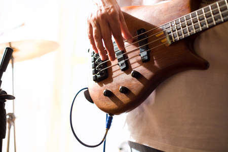 Musician play on bass guitar  photo