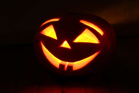 halloween pumpkin on black background photo