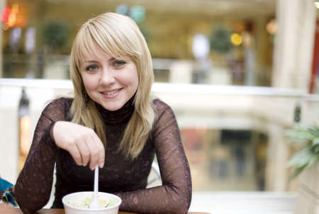 Woman eating ice-cream in a restaurant photo