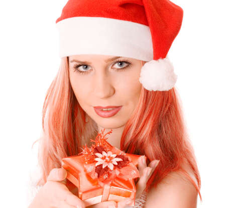 red head woman: Winter portrait of a beautiful young red head woman holding a gift in her hands. Over white background