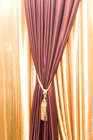 Purple velvet curtain with golden tassel Stock Photo - 2349402