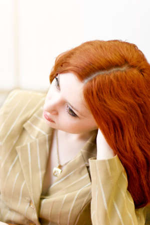 Attractive redhead woman in classical suit photo