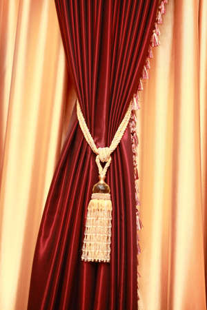 Purple velvet curtain with golden tassel. Close-up Stock Photo - 2748319