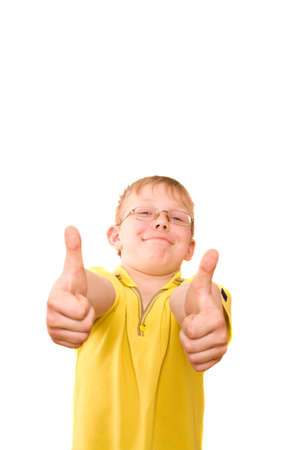 Photo of smiling teenager giving a rather enthusiastic thumbs up sign on two hands. photo
