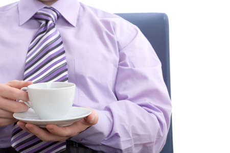 Young businessman drinking a nice warm cup of coffee at break. Isolated on white background Stock Photo - 3005088